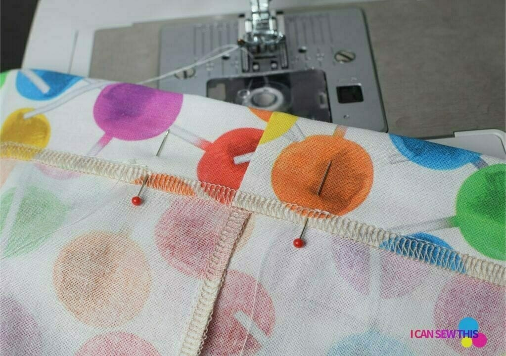 cotton fabric, pins, sewing machine