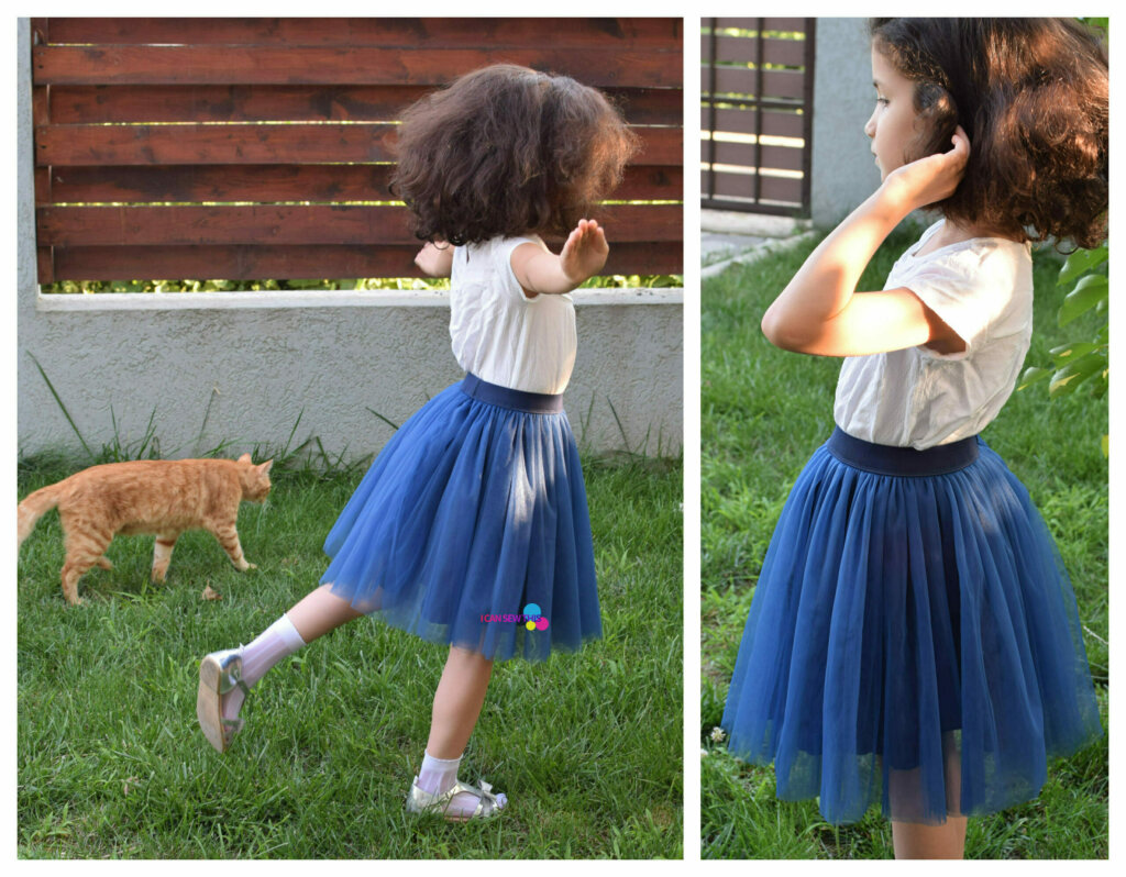 girl wearing a navy tulle skirt in the garden