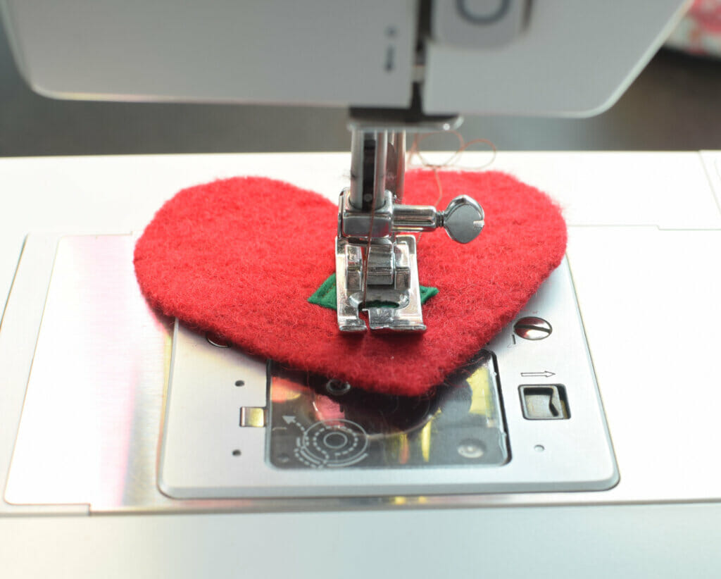 sewing machine, heart ornament