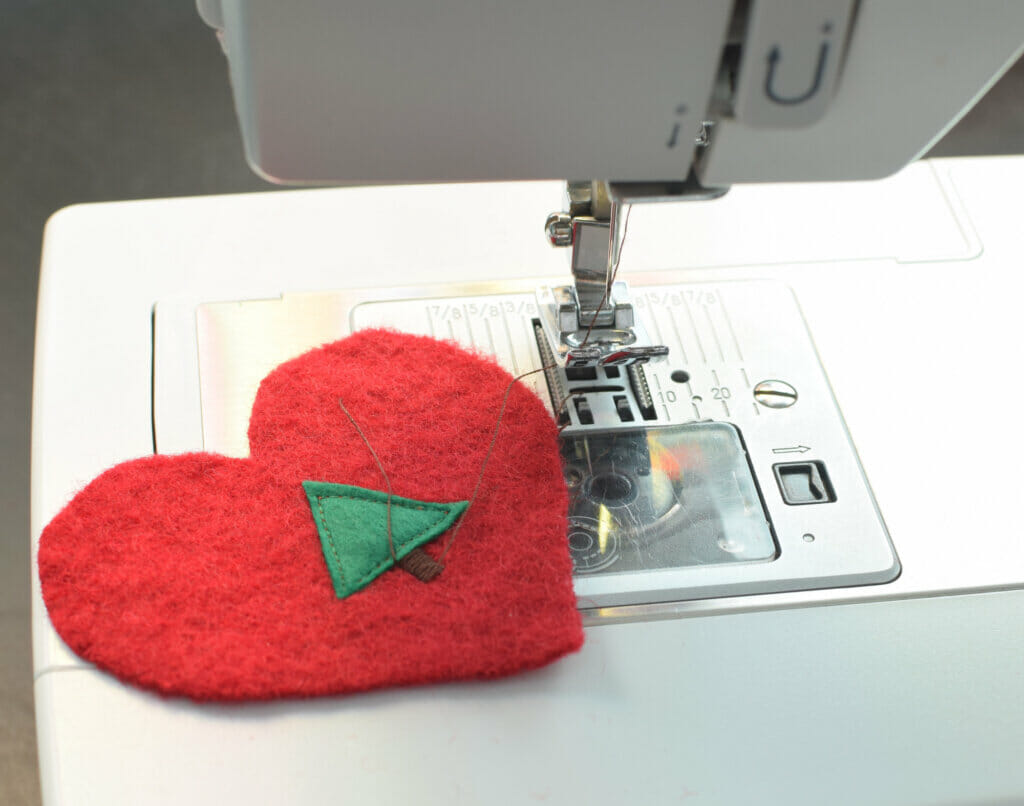 Christmas tree sewn on a wool heart