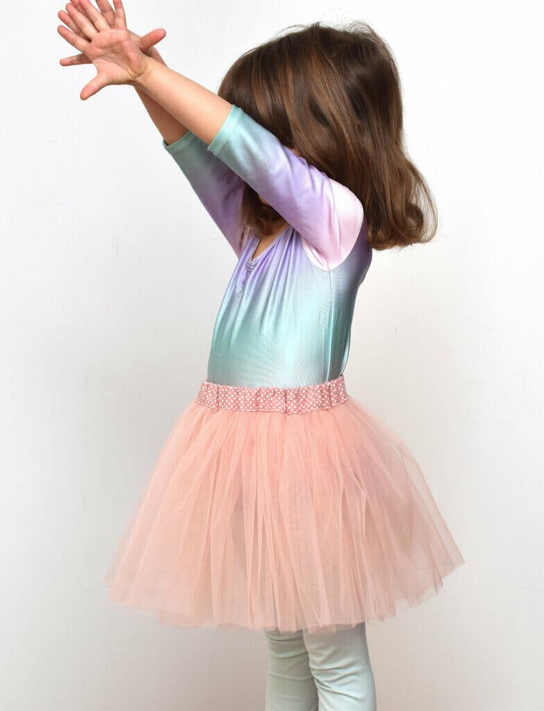 little girl in pink tutu skirt