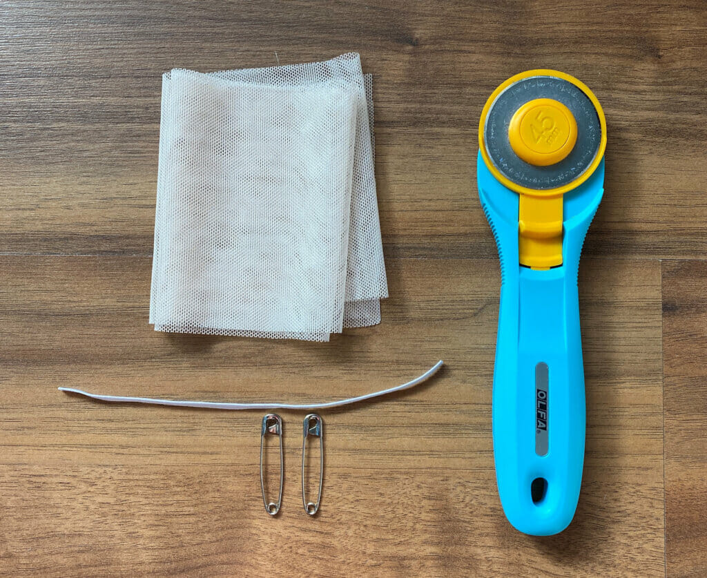 cut tulle fabric, rotary cutter