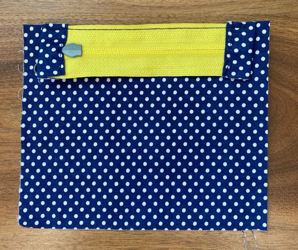 sew the zipper to the fabric panel